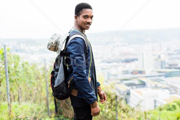 мужчины турист рюкзак улыбаясь Постоянный холме Сток-фото © Kzenon