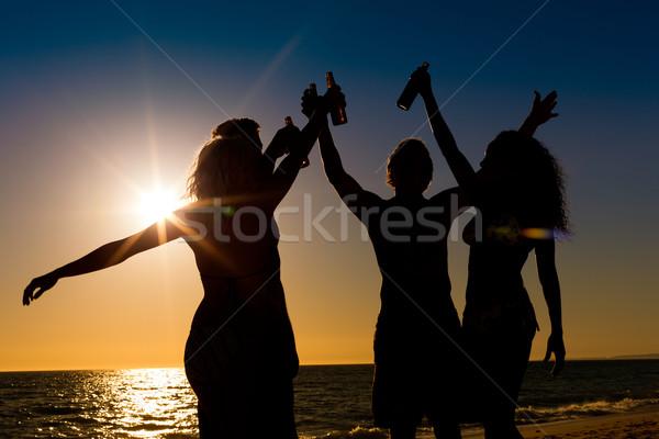 Persone party spiaggia bevande due coppie Foto d'archivio © Kzenon