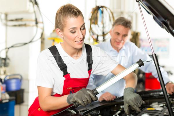 Mature man and female car mechanic in workshop Stock photo © Kzenon