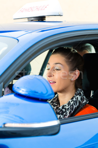 Young woman at driving lesson Stock photo © Kzenon