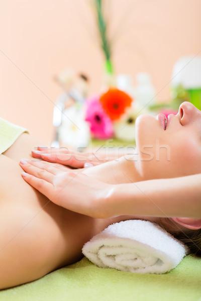 Wellness - woman getting shoulder massage in Spa Stock photo © Kzenon