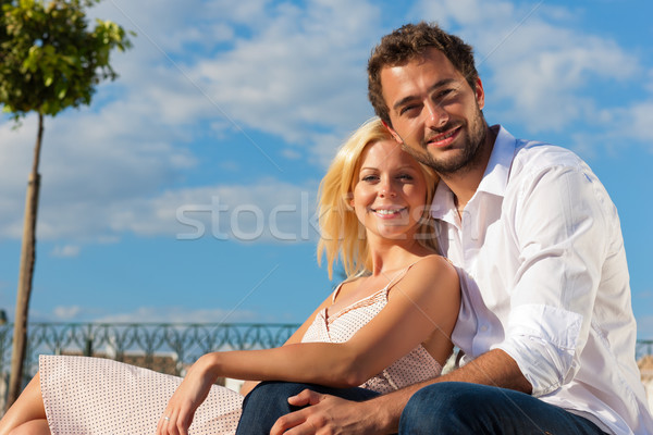 City tourism - couple in vacation on a bench Stock photo © Kzenon