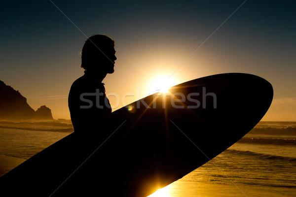 Surfer boord avond zon jonge strand Stockfoto © Kzenon