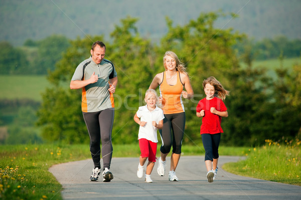 Family jogging outdoors Stock photo © Kzenon