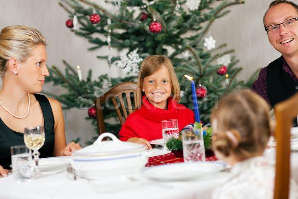 Family having Christmas Dinner Stock photo © Kzenon