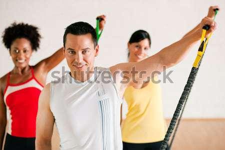 Fitness groep barbell gymnasium drie mensen Stockfoto © Kzenon