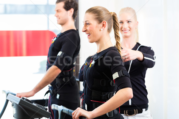 Stock photo: Coach giving ems training to couple