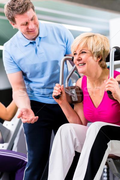 Сток-фото: старший · женщину · Личный · тренер · спортзал · сопротивление