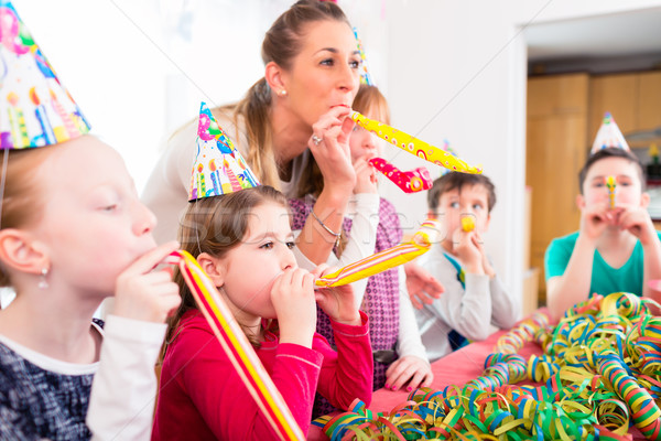 Children having birthday party with fun Stock photo © Kzenon