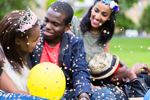 Indian girl and african couple celebrating together on street pa Stock photo © Kzenon