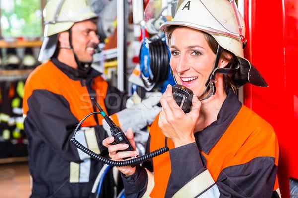 Chief fire fighter  checking radio set Stock photo © Kzenon