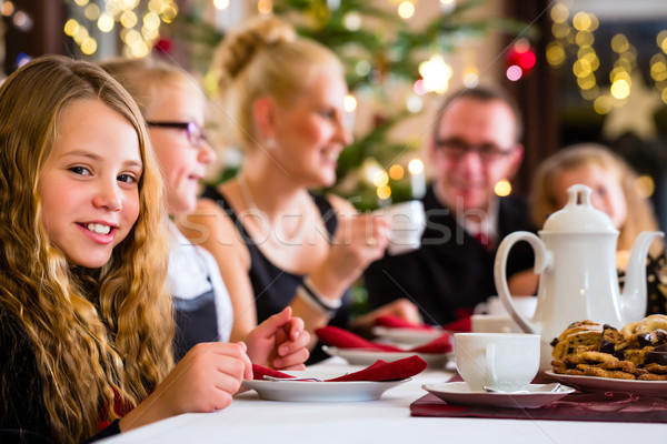 Family having traditional Christmas coffee time Stock photo © Kzenon