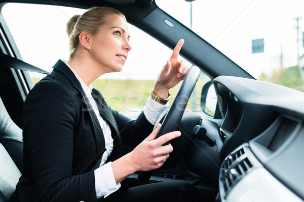 Woman in car being angry cursing other driver Stock photo © Kzenon