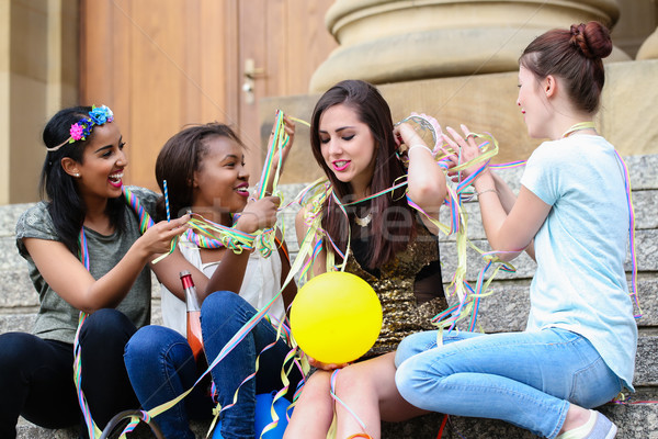 Friends decorate the bride with party streamers Stock photo © Kzenon