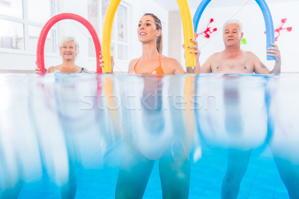 Group in water physical therapy training Stock photo © Kzenon