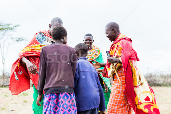 Stock photo: Massai family celebrating and dancing