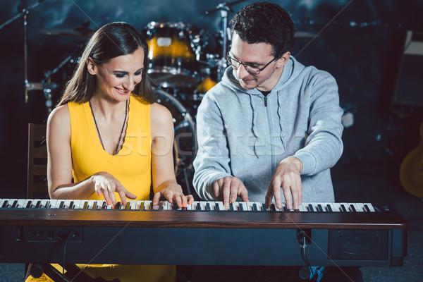 Piano teacher with his student in music school Stock photo © Kzenon