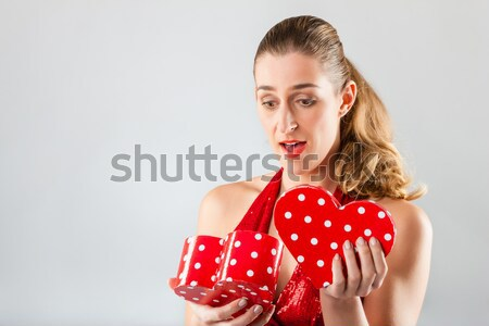 Woman opening the gift and is disappointed Stock photo © Kzenon
