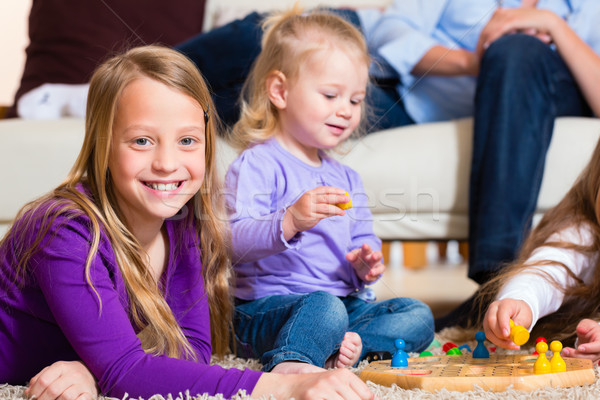 Family playing board game at home Stock photo © Kzenon