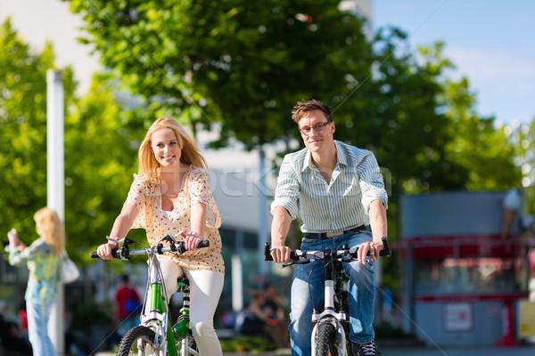 urban couple riding bike in free time in city Stock photo © Kzenon