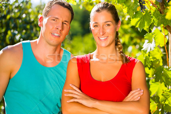 Woman and man standing in vineyard  Stock photo © Kzenon