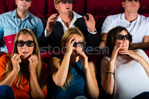 Group of people watching 3d movie at movie theater Stock photo © Kzenon