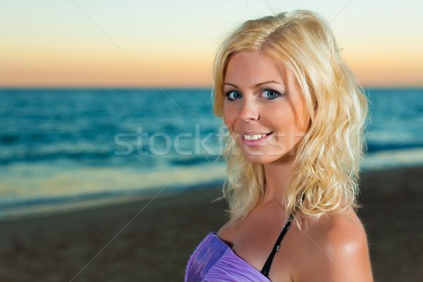 Attractive woman in the evening at sea Stock photo © Kzenon