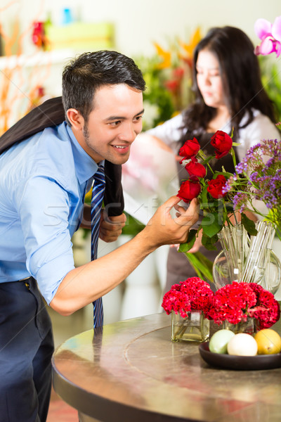 Saleswoman and customer in flower shop Stock photo © Kzenon