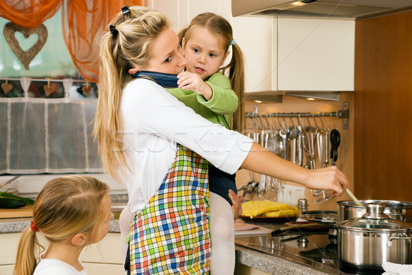 Housewife and children Stock photo © Kzenon