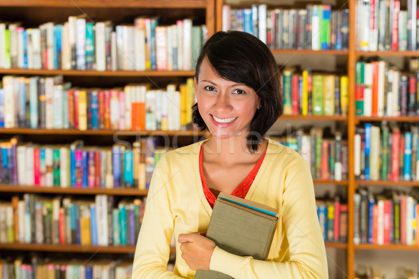 Girl in library holding a book Stock photo © Kzenon