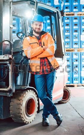 Builder driving site pallet transporter or lift fork truck Stock photo © Kzenon