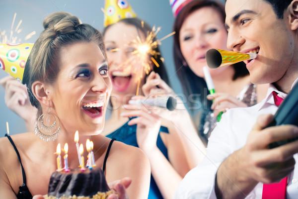 Party people in bar celebrating birthday Stock photo © Kzenon