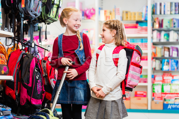 Two sisters buying school supplies in store Stock photo © Kzenon