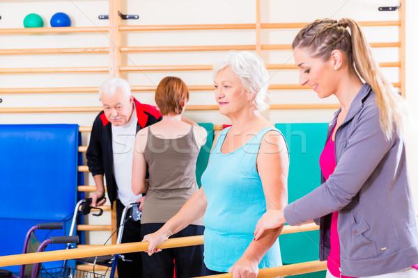 Seniors in physical rehabilitation therapy Stock photo © Kzenon