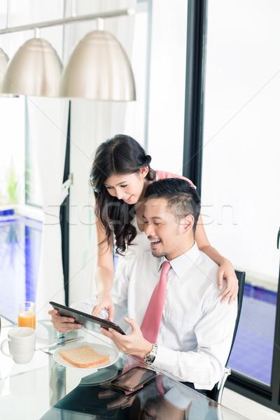 Couple having breakfast before man goes to office Stock photo © Kzenon