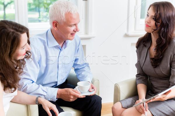 Advisor giving investment advice to senior couple Stock photo © Kzenon