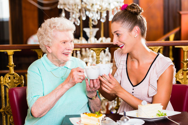 Senior woman and granddaughter at coffee in cafe Stock photo © Kzenon