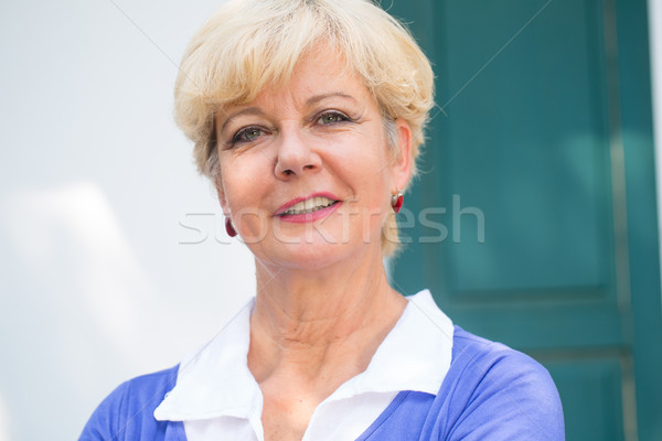 Close-up portrait of an elegant senior woman looking at camera w Stock photo © Kzenon