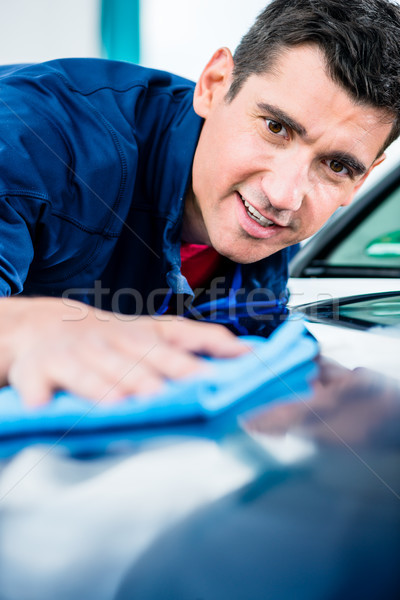 Man using an absorbent towel for drying the surface of a car Stock photo © Kzenon