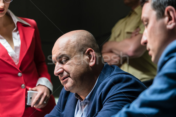 Middle-aged man calling his attorney Stock photo © Kzenon