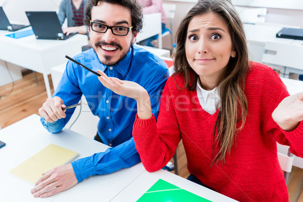 Students in College - woman having no clue Stock photo © Kzenon