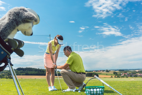 Full length of an experienced instructor teaching a young woman  Stock photo © Kzenon