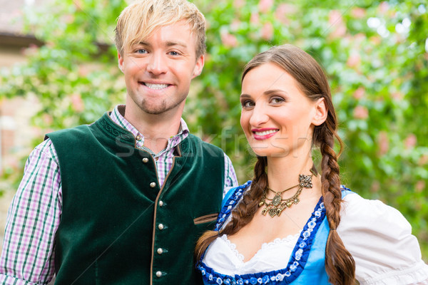 Couple posing in Bavarian clothes in beer garden Stock photo © Kzenon