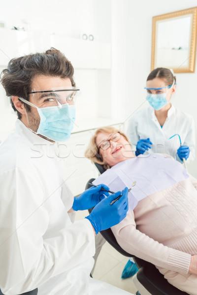 Dentist man in his surgery Stock photo © Kzenon