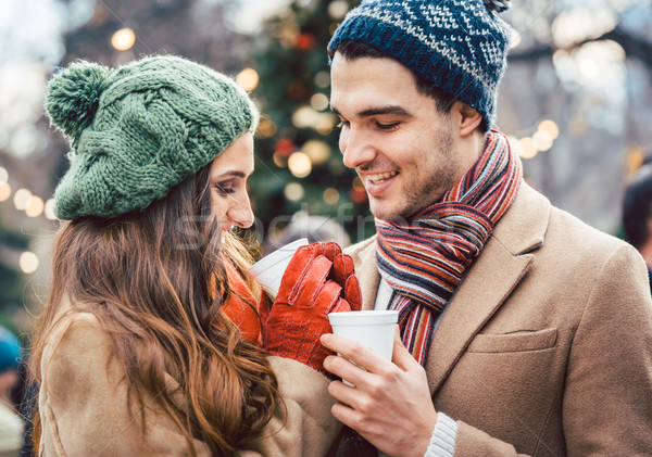 Stock photo: Woman and man drinking mulled wine on Christmas Market