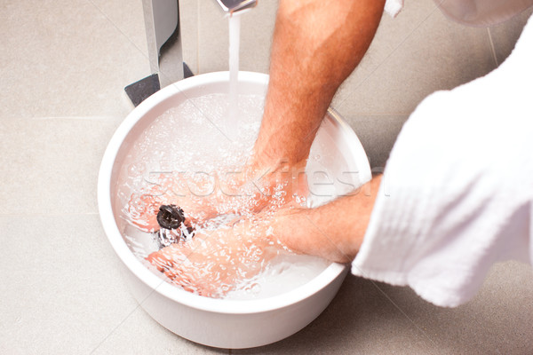 man having hydrotherapy water footbath Stock photo © Kzenon