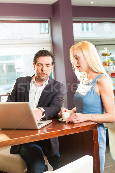 Stock photo: Working colleagues - a man and a woman - sitting in cafe