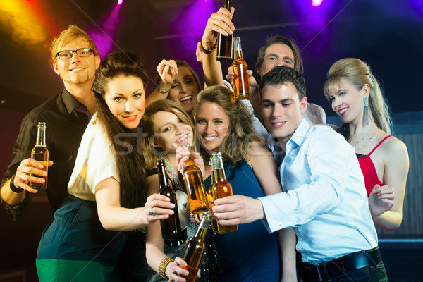 People in club or bar drinking beer Stock photo © Kzenon