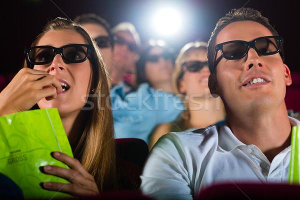 Jongeren kijken 3D film theater glimlach Stockfoto © Kzenon