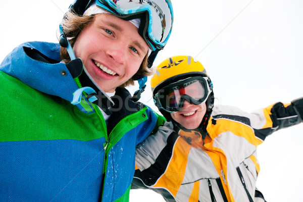 Skier and snowboarder in the snow Stock photo © Kzenon